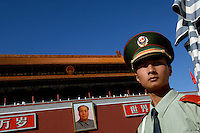 An honour guard stands below a portrait of Chairman Mao on Tiananmen Gate, Beijing, China. Mao is a revered figure in modern China almost thirty years after his death..17 Sep 05