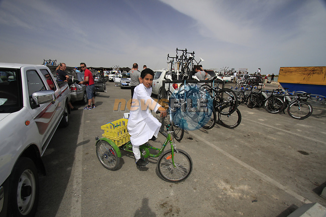 Local boy cycles around before the start of Stage 4 of the 2012 Tour of Qatar from Al Thakhira to Madinat Al Shamal, Qatar. 8th February 2012.<br /> (Photo Eoin Clarke/Newsfile)
