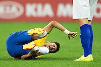 Neymar of Brazil rolls around in pain after a challenge