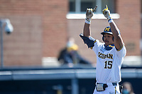 Michigan Wolverines outfielder Clark Elliott (15) celebrates after hitting his second home run during the NCAA baseball game against the Illinois Fighting Illini on March 20, 2021 at Fisher Stadium in Ann Arbor, Michigan. Michigan won the game 8-1. (Andrew Woolley/Four Seam Images)