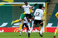 20th February 2021; Carrow Road, Norwich, Norfolk, England, English Football League Championship Football, Norwich versus Rotherham United; Oliver Skipp of Norwich City competes for the ball with Freddie Ladapo of Rotherham United