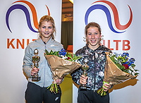 Wateringen, The Netherlands, December 15,  2019, De Rhijenhof , NOJK juniors doubles , Final girls14 years, runners up Nina Kwakman (NED)  and Isis van den Broek (NED) (R) with the trophy<br /> Photo: www.tennisimages.com/Henk Koster