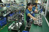 Workers inside CSST, china Security and Surveillance Technology, Shenzhen, China.  The comapny specialises in making surveillance cameras.