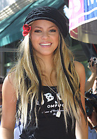 """Miami Beach, FL 11-14-2001<br /> Shakira makes an appearance at <br /> Spec's Music Store to promote<br /> the release of her new CD, <br /> """"Laundry Service"""".<br /> Photo by Adam Scull/PHOTOlink"""