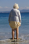Elderly British couple on holiday  Balearic Islands Pama Nova Majorca Spain Package holiday 'Young at Heart', 1980s. Older lady she has dowagers hump.