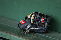 A Wilson baseball glove sits in the Kannapolis Intimidators dugout prior to the game against the Asheville Tourists at Intimidators Stadium on May 28, 2016 in Kannapolis, North Carolina.  The Intimidators defeated the Tourists 5-4 in 10 innings.  (Brian Westerholt/Four Seam Images)