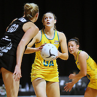 Australia's Susan Pratley looks to attempt a shot at goal while defended by New Zealand's Casey Williams in the New World Quad series netball match, Claudelands Arena, Hamilton, New Zealand, Thursday, November 01, 2012. Credit:NINZ / Dianne Manson.