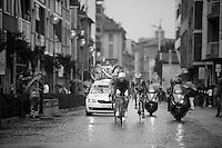 2013 Giro d'Italia.stage 14: Cervere - Bardonecchia.168km..Luca Paolini (ITA) leading an early breakaway in the wet cobbled main street of Savigliano