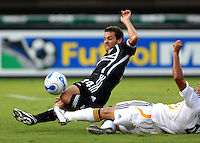 DC United midfielder Ben Olsen (14) slides for the ball while covered by Los Angeles Galaxy defender Ante Jazic (4). DC United defeated the Los Angeles Galaxy 1-0, at RFK Stadium Washington DC, Thursday August 9, 2007.