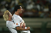 The United States' Brek Shea (20) gives Dilly Duka (10) a bear hug after he scored a goal against Cameroon in the second half during the FIFA Under 20 World Cup Group C Match between the United States and Cameroon at the Mubarak Stadium on September 29, 2009 in Suez, Egypt.