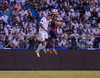 SAN PEDRO SULA, HONDURAS - SEPTEMBER 8: Cristian Roldan #7 of the United States heads the ball during a game between Honduras and USMNT at Estadio Olímpico Metropolitano on September 8, 2021 in San Pedro Sula, Honduras.