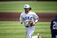 Duke Blue Devils shortstop Ethan Murray (1) in action against the Liberty Flames in NCAA Regional play on Robert M. Lindsay Field at Lindsey Nelson Stadium on June 4, 2021, in Knoxville, Tennessee. (Danny Parker/Four Seam Images)