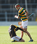 Cathal Doohan of Ballyea gets a clip from  Stephen Mc Donnell of Glen Rovers during their Munster Club hurling final at Thurles. Photograph by John Kelly.