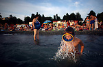 A boy emerges from the water in his scuba diving mask as beach-goers enjoy the warm weather on Thursday, August 14, 2008, at the Black Sea resort Sochi, Russia. The government has pledged to invest $12 billion to transform the Soviet-era resort town into a Mediterranean-style retreat.   As the mountainous Black Sea resort Sochi, Russia, prepares for the Winter Olympic games scheduled there for 2014, it emerges as a place replete with contradictions -- glitzy clubs and impoverished street vendors, progress and repression, Westernization and former Eastern bloc ideologies.