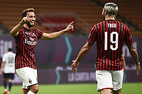 Hakan Calhanoglu of AC Milan celebrates with Theo Hernandez after scoring a goal during the Serie A football match between AC Milan and Bologna FC at stadio Giuseppe Meazza in Milano ( Italy ), July 18th, 2020. Play resumes behind closed doors following the outbreak of the coronavirus disease. <br /> Photo Image Sport / Insidefoto