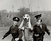 Officer losing his cap was Bob Olsen's winning picture; He took the best feature photograph during a police soccer practice May 6.1969