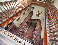 """BNPS.co.uk (01202) 558833. <br /> Pic: KnightFrank/BNPS<br /> <br /> Pictured: Staircase. <br /> <br /> A castle that was burnt down by a pirate, involved in the English Civil War and has been in the same family for five centuries is on the market for offers over £650,000.<br /> <br /> Kilberry Castle, which dates back to the 15th century, has an incredible history and still has a wealth of original features including a 288-year-old mausoleum.<br /> <br /> It sits in 21 acres of land on the Scottish west coast, with stunning views over Kilberry Bay and out to the islands of Islay, Jura and Gigha.<br /> <br /> The four-storey tower house now needs a buyer """"with deep pockets and great imagination"""" to carry out a complete refurbishment but it has a lot of potential."""