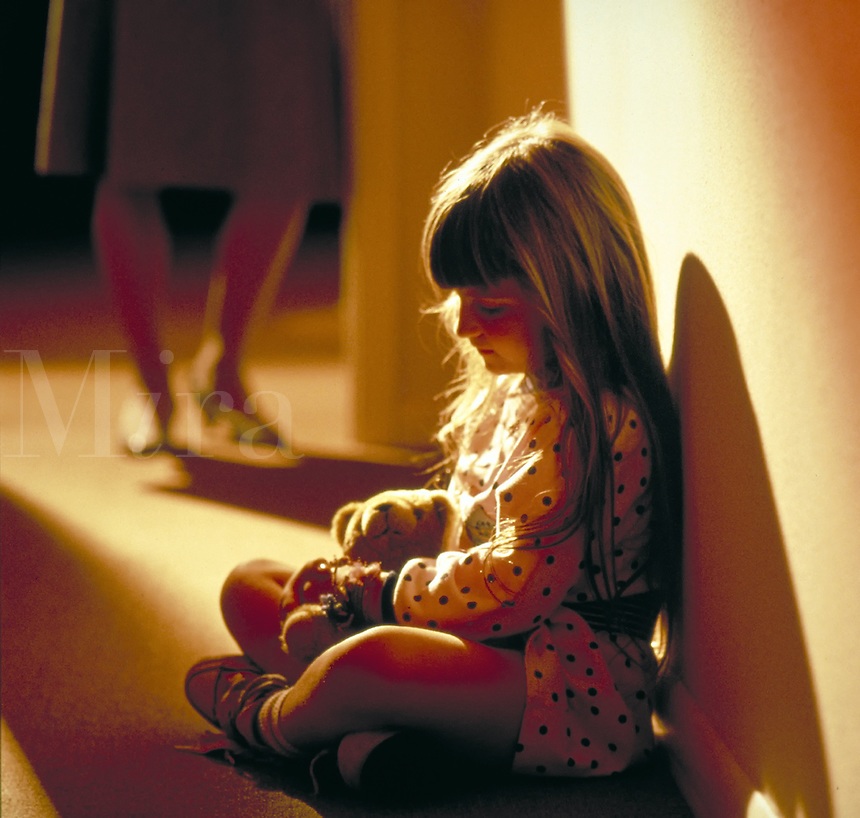 ABUSE CONFLICT SAD CHILD FRUSTRATED PARENT  LOWER LEGS OF ADULT WOMAN IN VIEW  TIME OUT  GIRL CHILDREN  NEGLECT. ANNMARIE.