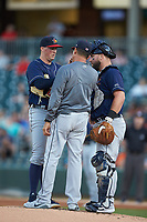 Toledo Mud Hens pitching coach Juan Nieves (center) has a meeting on the mound with starting pitcher Kyle Funkhouser (left) and catcher Cameron Rupp (26) during the game against the Charlotte Knights at BB&T BallPark on April 24, 2019 in Charlotte, North Carolina. The Knights defeated the Mud Hens 9-6. (Brian Westerholt/Four Seam Images)