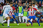 Kevin Gameiro of Club Atletico de Madrid battles for the ball with Mikel Villanueva of Malaga CF during their La Liga match between Club Atletico de Madrid and Malaga CF at the Estadio Vicente Calderón on 29 October 2016 in Madrid, Spain. Photo by Diego Gonzalez Souto / Power Sport Images
