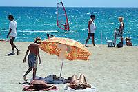 "Spain. Mallorca in the Balearic islands. Palma. Tourists take a rest, sunbathe and sleep in the sandy beach of "" Playa de Palma"". Mediterranean sea.© 1999 Didier Ruef"