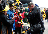 Photo: Richard Lane/Richard Lane Photography. Wasps v Newcastle Falcons. Aviva Premiership. 06/02/2016. Wasps' Director of Rugby, Dai Young signs autographs for supporters as the team arrive at the stadium.