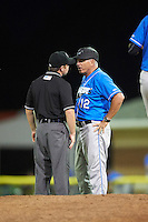 Hudson Valley Renegades manager Tim Parenton (12) argues a call with umpire John Budka during a game against the Batavia Muckdogs on August 2, 2016 at Dwyer Stadium in Batavia, New York.  Batavia defeated Hudson Valley 2-1.  (Mike Janes/Four Seam Images)