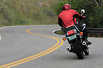 Male motorcyclist riding on Lookout Mountain Road west of Denver, Colorado, USA .  John offers private photo tours in Denver, Boulder and throughout Colorado. Year-round.