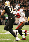 December 2009: New Orleans Saints wide receiver Marques Colston (12) stiff arms Tampa Bay Buccaneers safety Tanard Jackson (36) after catching the ball during an NFL football game at the Louisiana Superdome in New Orleans.  The Buccaneers defeated the Saints 20-17.