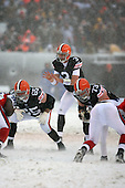 December 16th, 2007:  Cleveland Browns quarterback Derek Anderson (3) calls the signals as offensive lineman Eric Steinbach (65) and Joe Thomas (73) get ready at Cleveland Browns Stadium in Cleveland, Ohio.  The Browns shutout the Bills 8-0.  Photo copyright Mike Janes Photography 2007.