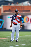Quad Cities River Bandits development coach Rafael Pena (20) during a game against the West Michigan Whitecaps on July 23, 2018 at Modern Woodmen Park in Davenport, Iowa.  Quad Cities defeated West Michigan 7-4.  (Mike Janes/Four Seam Images)