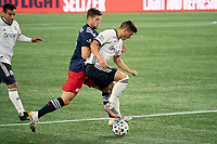 FOXBOROUGH, MA - OCTOBER 19: Anthony Fontana #21 of Philadelphia Union stops the ball to avoid a tackle by Matt Polster #8 of New England Revolution during a game between Philadelphia Union and New England Revolution at Gillette on October 19, 2020 in Foxborough, Massachusetts.