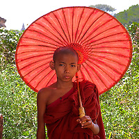 Myanmar, Burma. Bagan.  Young Novice Monk and Umbrella.