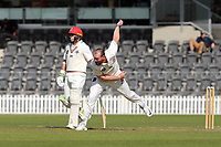 Iain McPeake bowls during Day 1 of Round Two Plunket Shield cricket match between Canterbury and Wellington at Hagley Oval in Christchurch, New Zealand on Wednesday, 28 October 2020. Photo: Martin Hunter / lintottphoto.co.nz