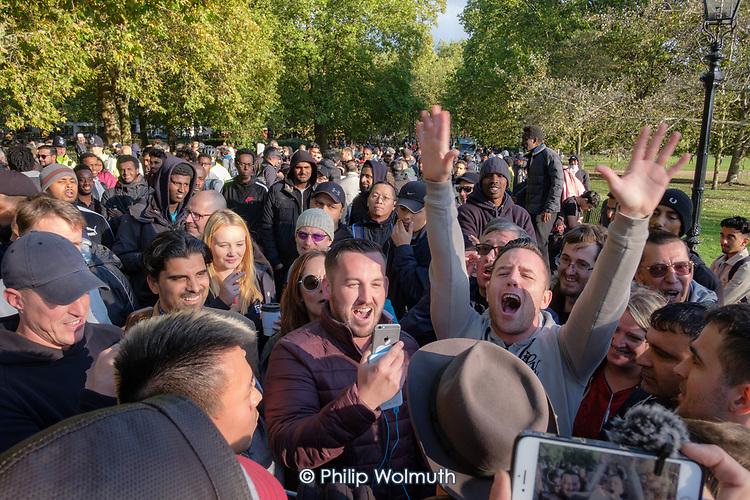 Veteran Marxist speaker Heiko Khoo argues with Tommy Robinson supporters, Speakers' Corner, Hyde Park, London.