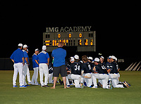 IMG Academy Ascenders team huddle after a game against the Canterbury Cougars on April 21, 2021 at IMG Academy in Bradenton, Florida.  (Mike Janes/Four Seam Images)