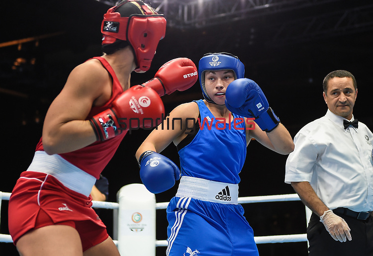 Wales Lauren Price in action against Kaye Scott <br /> <br /> Photographer Ian Cook/Sportingwales<br /> <br /> 20th Commonwealth Games - Boxing -  Day 7 - Wednesday 30th July 2014 - Glasgow - UK