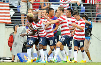 Eddie Johnson (26) of the USMNT celebrates  his score with teammates. The USMNT defeated El Salvador 5-1 at the quaterfinal game of the Concacaf Gold Cup, M&T Stadium, Sunday July 21 , 2013.