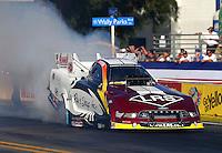 Nov 7, 2013; Pomona, CA, USA; NHRA funny car driver Tim Wilkerson during qualifying for the Auto Club Finals at Auto Club Raceway at Pomona. Mandatory Credit: Mark J. Rebilas-