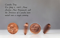 Spinning Canadian Pennies with the text:  Canada Day -  On July 1, 1867 Nova Scotia, New Brunswick, and the Province of Canada were united into a single country.