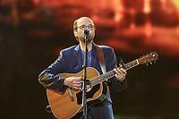 Michel Rivard performs during the Hommage a Felix Leclerc concert at the Festival d'ete de Quebec on the plains of Abrahams in Quebec City Thursday July 3, 2014.