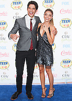 LOS ANGELES, CA, USA - AUGUST 10: Tyler Posey and Sarah Hyland arrive at the Teen Choice Awards 2014 held at The Shrine Auditorium on August 10, 2014 in Los Angeles, California, United States. (Photo by Celebrity Monitor)