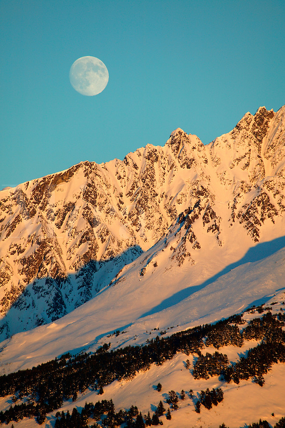 Winter moonrise over the Resurrection Peninsula and the Chugach National Forest, from Seward, Alaska.