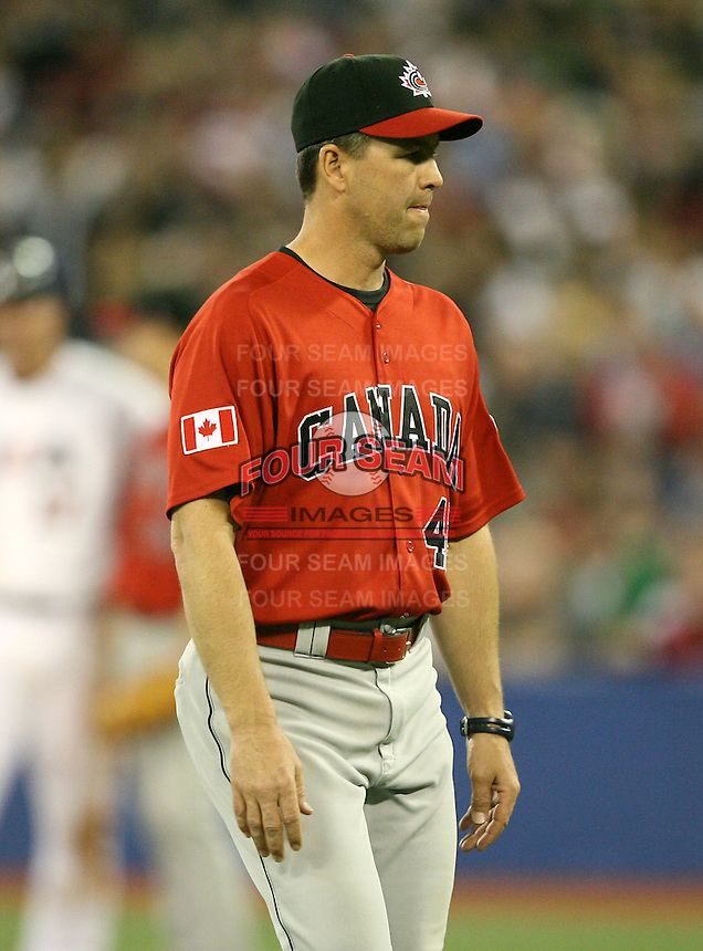 March 7, 2009:  Pitching Coach Dennis Boucher of Canada during the first round of the World Baseball Classic at the Rogers Centre in Toronto, Ontario, Canada.  Team USA defeated Canada 6-5 in both teams opening game of the tournament.  Photo by:  Mike Janes/Four Seam Images