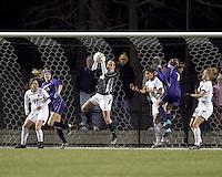 "Boston College goalkeeper Jillian Mastroianni (30) grabs a corner kick. In overtime, Boston College defeated University of Washington, 1-0, in NCAA tournament ""Elite 8"" match at Newton Soccer Field, Newton, MA, on November 27, 2010."
