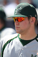USF Bulls infielder Nick Alfonso #8 in the dugout before a scrimmage against the New York Yankees at Steinbrenner Field on March 2, 2012 in Tampa, Florida.  New York defeated South Florida 11-0.  (Mike Janes/Four Seam Images)