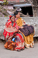India, Rishikesh.  Two Indian Women Sitting on a Bench.