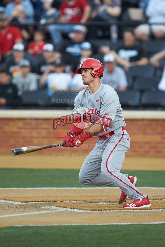 Luca Tresh (24) of the North Carolina State Wolfpack follows through on his swing against the Wake Forest Demon Deacons at David F. Couch Ballpark on April 18, 2019 in  Winston-Salem, North Carolina. The Demon Deacons defeated the Wolfpack 7-3. (Brian Westerholt/Four Seam Images)
