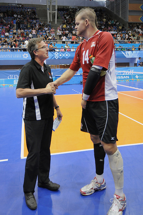 Henry Storgaard and Greg Stewart, Guadalajara 2011 - Sitting Volleyball // Volleyball Assis.<br /> Team Canada defeats Columbia in the Bronze Medal Game // Équipe Canada bat Columbia dans le match pour la médaille de bronze. 11/18/2011.