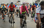A group of cyclists ride in the annual Tour de Houston bike ride downtown Sunday  March 16, 2014.(Dave Rossman photo)
